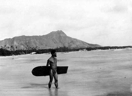 B15, By the End of the 19th Century Surfing Was its Lowest Ebb.  This Lone Hawaiian Surfer at Waikiki Beach Carries One of the Last Alaia Boards to Be Ridden There.